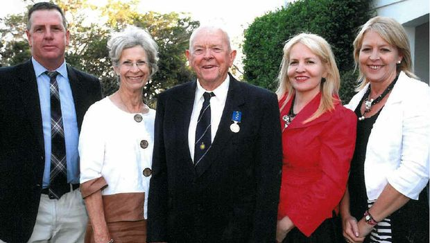 CENTRAL FIGURE: John Purcell (centre) with his family at his OAM award ceremony (from left) son Jason, wife Mary, and daughters Patrice Brown and Rebecca Reid.