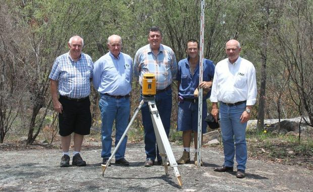 BUILDING SITE: Duffy Constructions Qld Pty Ltd director Joseph Duffy, Crisp Real Estate agent John Graham, Top of Town Tourist Park owner David Marks, Duffy Constructions director Oisin Duffy and Crisp Real Estate owner Norman Crisp survey the site of the first and display bungalow. Photo Linden Morris / Stanthorpe Border Post