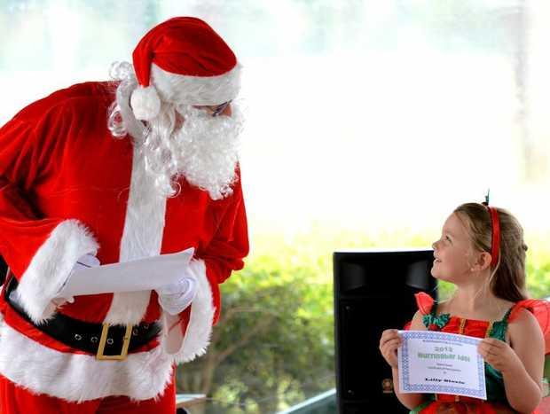 Burringbar public school, kids idol competition. Special guest judge Santa talks to Lilly Steele. Photo: John Gass / Daily News