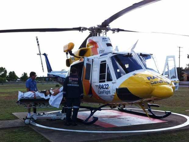 CareFlight paramedics treat a 30-year-old man involved in a motor vehicle rollover at Chinchilla.