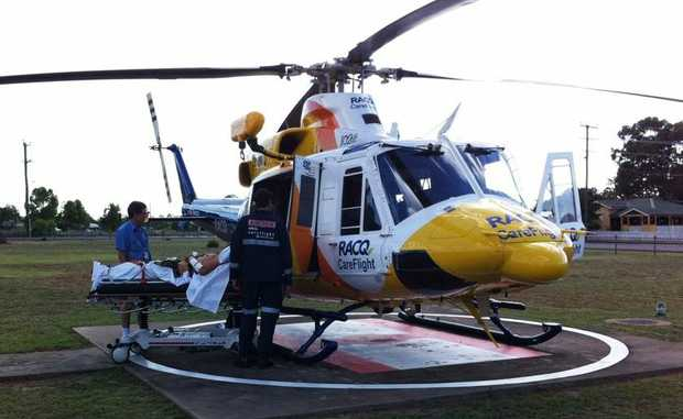 CareFlight paramedics treat a 30-year-old man involved in a motor vehicle rollover at Chinchilla.