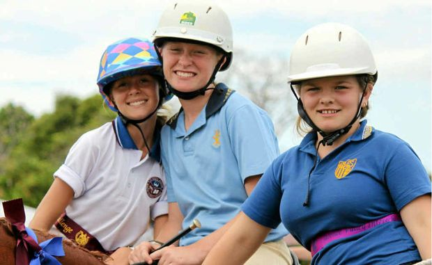 Three good friends, from left Tara Kelly McAuley Catholic College, Lindsey Blanch Clarence Valley Anglican School and Niav Bacon of Grafton Public School, all aged 12 years, rode against each other while they represented their individual school.