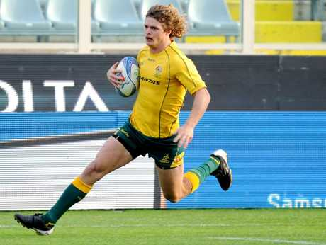 Nick Cummins of Australia scores a breakaway try during the international rugby test match between Italy and Australia at Artemio Franchi on November 24, 2012.