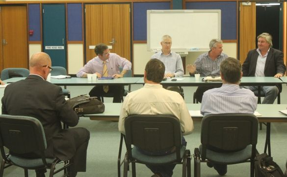 Minister for Agriculture, Fisheries and Forestry John McVeigh (in purple) and chief biosecurity officer Jim Thompson meet with cattle producers and representatives from the Australian Brahman Breeders Association, AgForce and the Cattle Council of Australia to discuss the discovery of Bovine Johne's disease on a cattle property at Bajool.