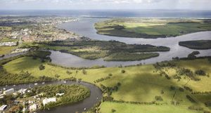 HEAVEN SENT: John Gallagher in his office, left; the river at Ballina, below left. Below right, the Burns Point ferry.