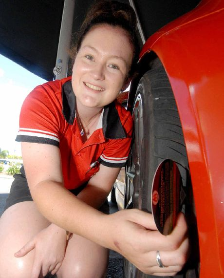 SAFETY CHECK: Jessica Clair, of the M Group, checks the tyre tread depth on a car in Porters car park yesterday.