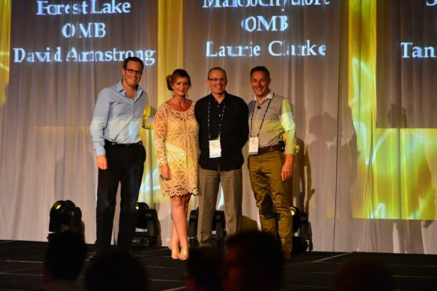 Laurie and Debbie Clarke being congratulated by BOQ Retail and Online Banking Executive Matt Baxby (left), and BOQ Managing Director and Chief Executive Officer Stuart Grimshaw (right).
