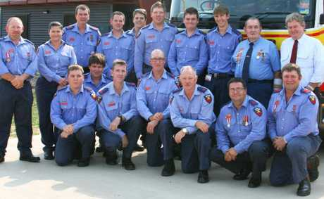 Gregory MP Vaughan Johnson poses with firefighters outside the new $4m
