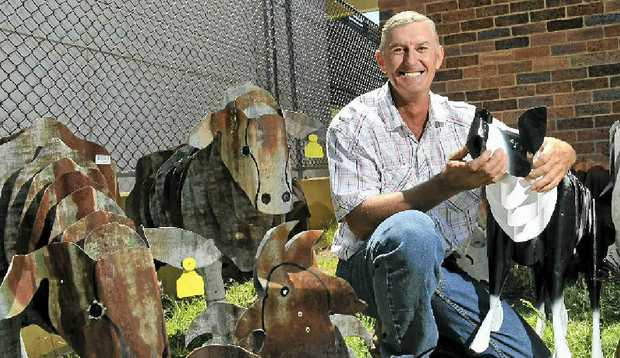 METAL MASTERPIECES: Michael Walsh spends roughly six hours creating an animal and so far credits the sheep as his favourite to make. He is one of many exhibitors showcasing his homemade products at the Bush Christmas Exhibition.