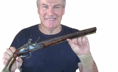 FIRED UP: Don Mahoney with a Dragoon Horse holster pistol, which dates back to the 1730s. It is one of the items to be auctioned at Nebo tomorrow.
