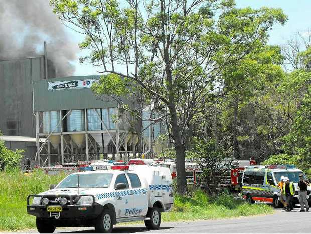 AT THE READY: Emergency services take charge at a fire in the Riverina Stockfeeds plant.