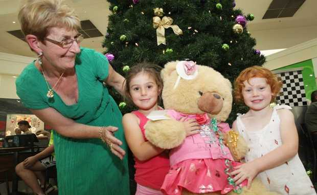 Chiara Wise and Akeisha Wise received a teddy bear from Heather Burney from Wish. Photo: Inga Williams / The Reporter