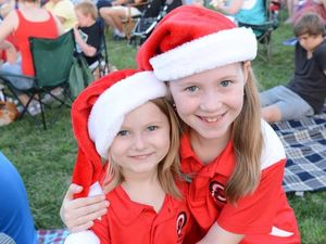 Chelsea and Maddie Higgins enjoy a night of festive fun and entertainment at Brassall's Christmas in the Park event on Friday night. Photo: Sarah Harvey / The Queensland Times