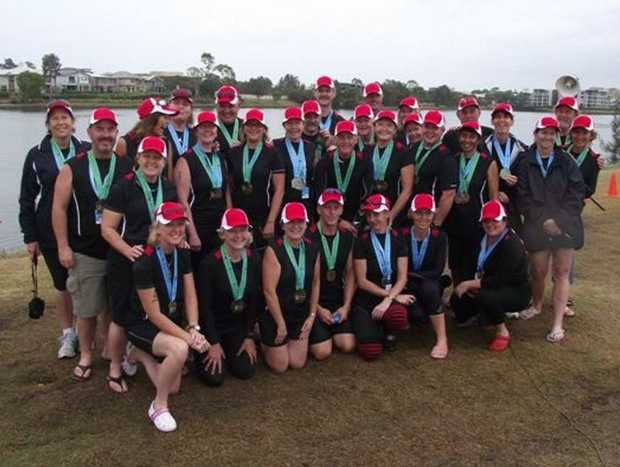 Dragon boat paddlers from clubs from the Tweed compete in the Pan Pacific Masters Games at Lake Orr on the Gold Coast.
