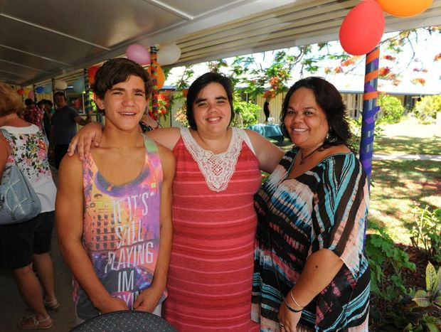 GOOD WORK: Charlene Paulson (centre), who has graduated from the Latch-On program, is supported by her brother Jackson and mother Debbie.