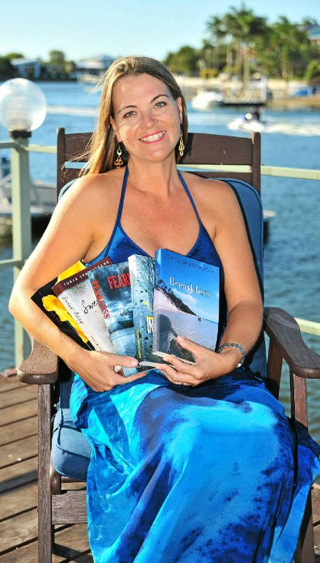 Tonya Sharp Hyche shows off her collection of novels, all written since moving from the United States in 2010.