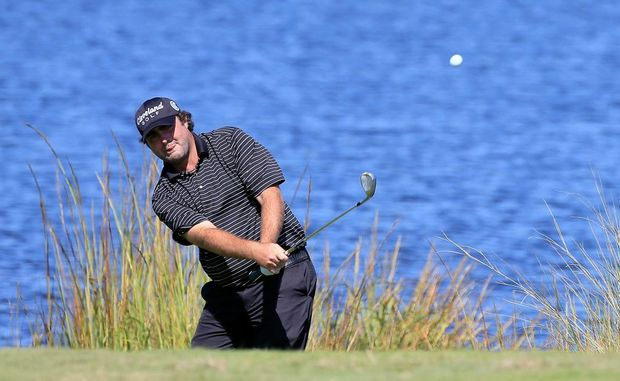 Steven Bowditch plays a shot on the 16th hole during the second round of The McGladrey Classic at Sea Island's Seaside Course on October 19, 2012 in Sea Island, Georgia.