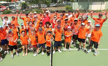 Players and coaches show their club spirit at the recent Aspire Tennis Club family fun day.