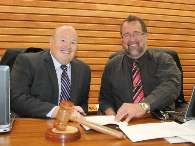 New SDRC CEO Andrew Roach and mayor Peter Blundell sign on the dotted line.