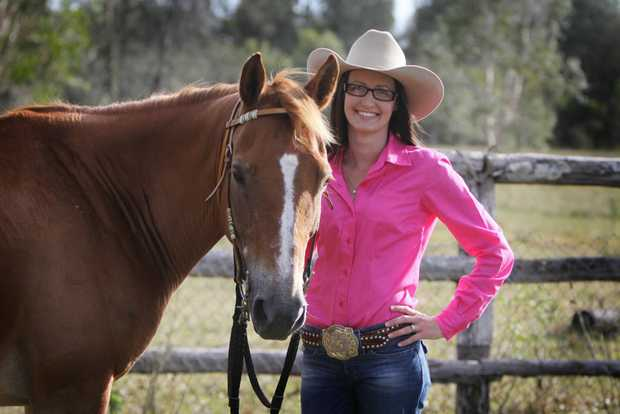 Stacey Freeman with Billy is pretty in pink for the barrell racing championships this weekend.