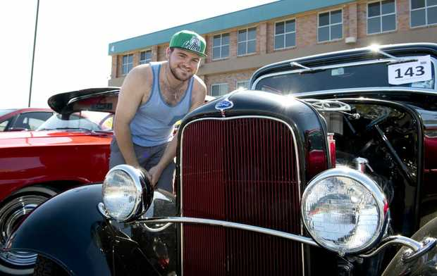 Shaun Devey admires a 1932 Ford. St Andrews Hospital Show and Shine. Photo Nev Madsen / The Chronicle