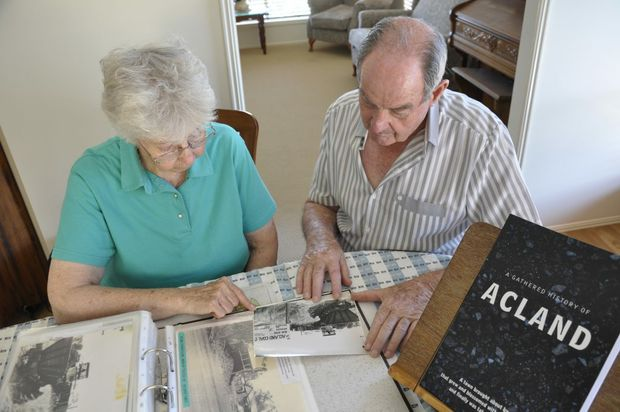 Former Acland residents Kath and John Greenhalgh revisiting historic photos of the Acland district.