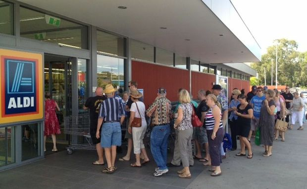 Crowds queue at Aldi to grab the Onix tablet deal.