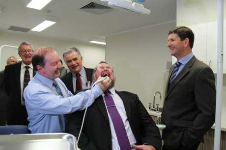 PEARLY WHITES: Health Minister Lawrence Springborg looked on as Professor Ward Massey and SDRC mayor Peter Blundell tested out the new dentist chair at the Warwick Hospital. Cr Blundell said the continuation of fluoride in S