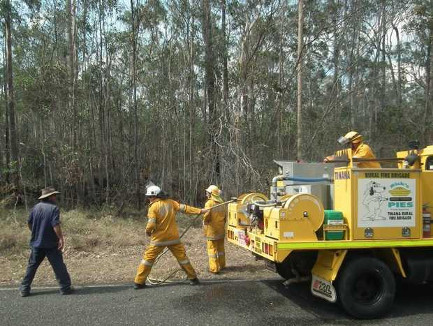 Rural firefighters and locals combined to fight the fire at Aramara on Tuesday.