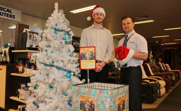 CHRISTMAS SPIRIT: Harvey Norman in Kingaroy are in the Christmas spirit and are collecting and adding to gifts for the Kids in Care Christmas Appeal for children in the South Burnett (from left) Ryan Freestone and Damian Corkett.