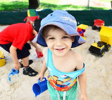 SANDY SUMMER: Finn Mulvogue enjoys the sandpit at the Goodna Community Centre.