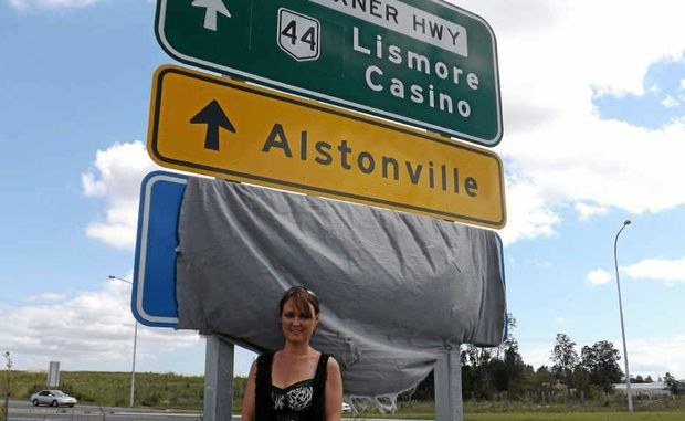 SIGN WELCOMED: Alstonville Chamber of Commerce vice-president Candy Fitness and the new sign for Alstonville.