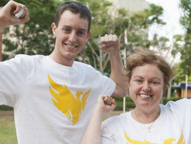 "Warwick local Alex Darton poses for a photo in the new ""Phoenix"" t-shirts with USQ Vice-Chancellor Professor Jan Thomas."