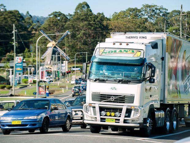 Opposition leader Tony Abbott drives a semi trailer through Coffs Harbour.