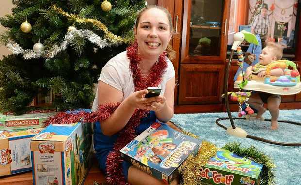 ONLINE SHOPPER: Laura Loveday, pictured with her nine-month-old son Toby, has done all of her Christmas shopping over the internet. Ipswich is one of the most prolific areas for online shopping.