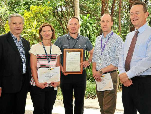 HEALTH AWARD: Paul Thomas, Dr H. H. Moy Memorial Medal finalist Dr Elaine Mawdsley, medal winner Mark Forrest, medal finalist Dr Nick Gray and health service chief Kevin Hegarty