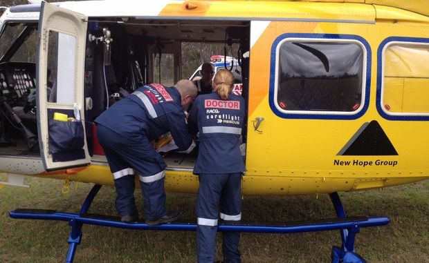 A CareFlight doctor and flight paramedic prepare a woman, who was airlifted to Brisbane after suffering suspected spinal injuries from falling off a horse.