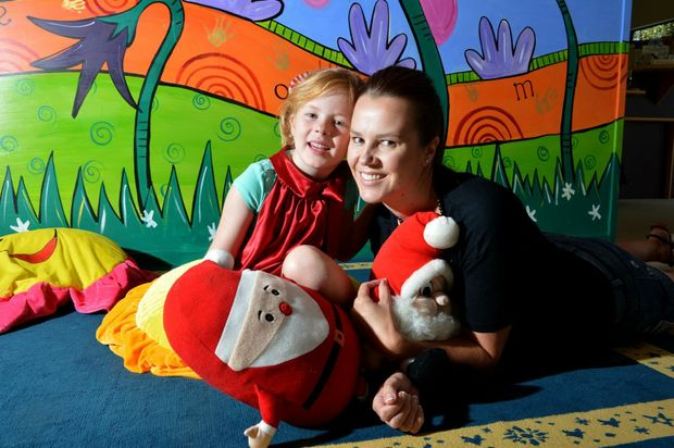 Five-year-old Sloane Murphy, with her mum Kristy, has graduated from the Sunshine Coast Hear and Say Centre.