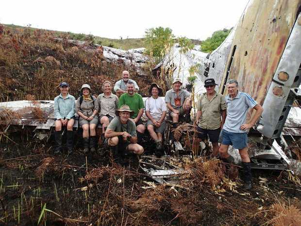 Ray Gresham (centre, in white shirt) poses at the B17 wreck.