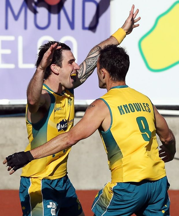 Kieran Govers of Australia celebrates scoring the winning goal in extra time with Mark Knowles to defeat the Netherlands in the final of the 2012 Champions Trophy at State Netball Hockey Centre on December 9, 2012 in Melbourne, Australia.