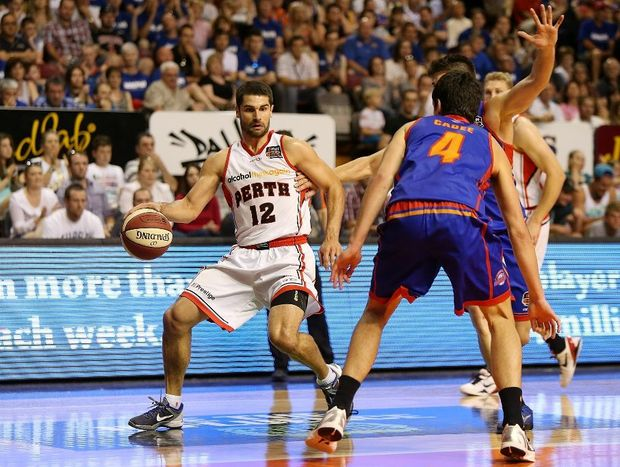 Kevin Lisch of Perth runs with the ball during the round ten NBL match between the Adelaide 36ers and the Perth Wildcats at Adelaide Arena on December 9, 2012.