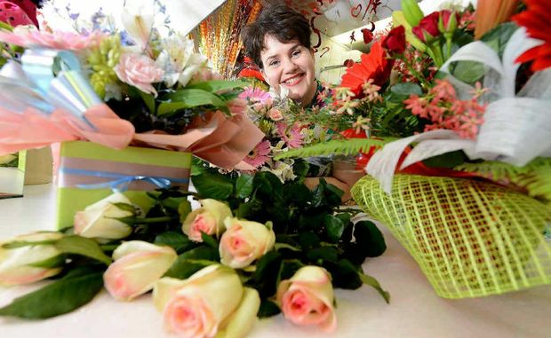 Brassall Florist owner Angela Jacob is preparing flowers for a wedding on 12/12/2012.