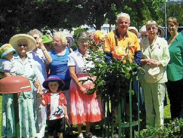 FINE WORK: Guests enjoy the special rose planting ceremony to honour outstanding QCWA work.