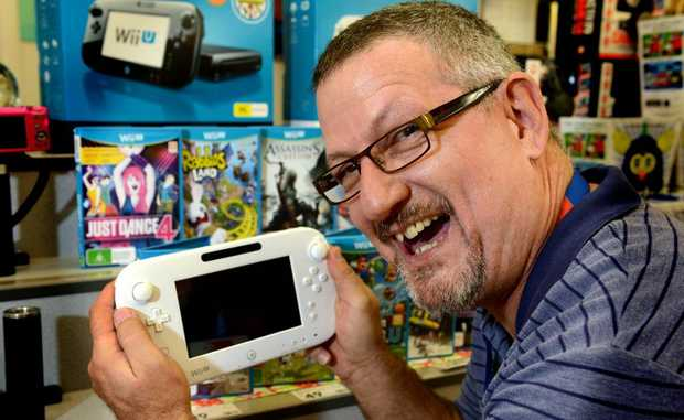 Tweed City Kmart general merchandise manager Randy Hays with the new WiiU.