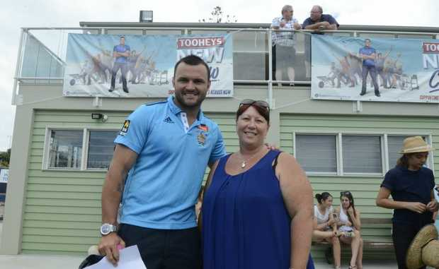 Beau Champion and Robyn Wonson in front of the completed work at Fingal Rovers.