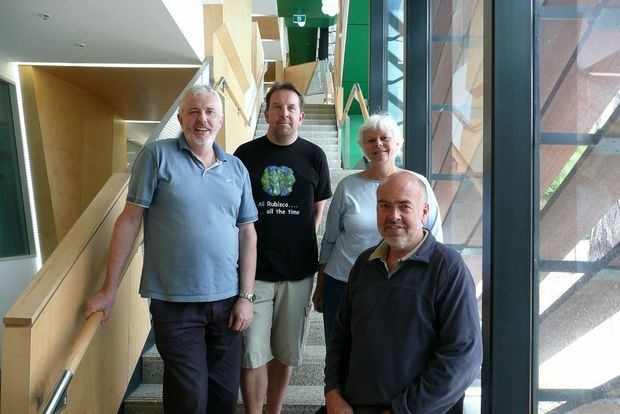 The C4 photosynthesis team, from left, Associate Professor Dean Price, Associate Professor Spencer Whitney, Professor Susanne von Caemmerer and Professor Murray Badger. The unusual T-shirt motif refers to the C3 photosynthesis enzyme they are researching.