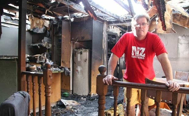 IT'S ALL GONE: Peter Makings stands in disbelief in his burnt out apartment.