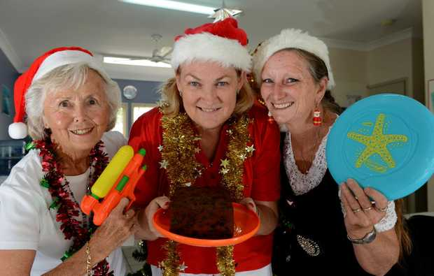 Pat Tate, Kay Newman, Colleen Duncalfe getting ready for a Christmas Day party.
