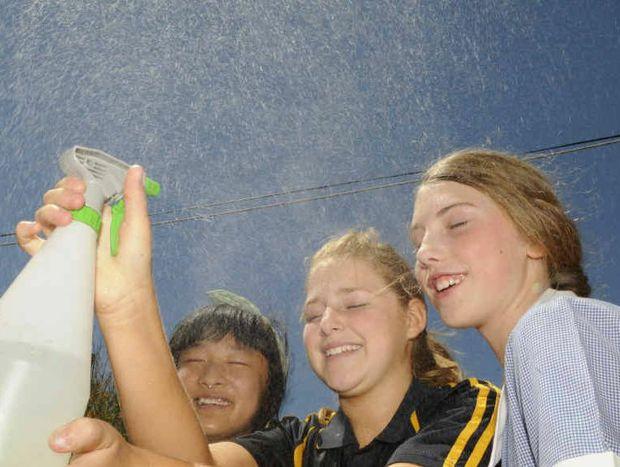 WAITING FOR RAIN: Christina Zhana, Hailee Jensen and Isabel beat the heat.