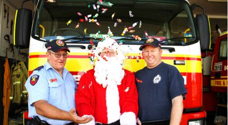 "CHRISTMAS CANDY: Lieutenant Mal McIver, ""Santa"" and firefighter Wayne Vesey took part in the lolly drop in Blackwater on Monday afternoon."